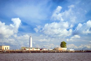 Lighthouse on spit in Kronstadt in August Sunny day