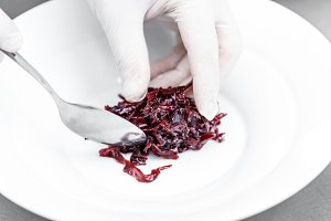 Chef serving spicy red cabbage