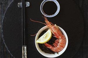 chopsticks, shrimp and sauce, selective focus