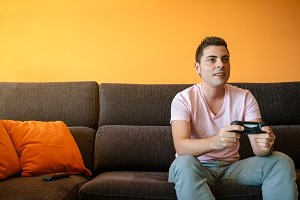 Man playing with console