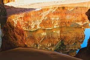 Reflection of yellow rocks