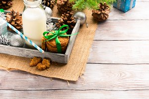 Milk and cookies for Santa on wooden table. Copy space