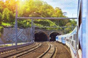 Passenger train locomotive enters the tunnel. Prague