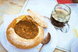 Goulash soup in bread in Strahov brewery, Prague