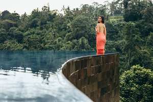 Attractive woman in infinity pool