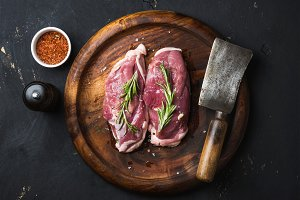 Raw duck breast with rosemary