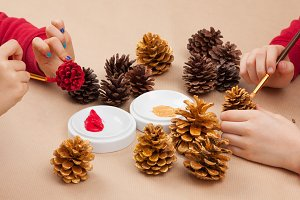 Children painting pinecones