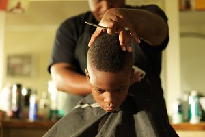 little boy at barbershop