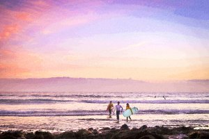Surfers surf on waves, bright sunset