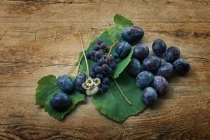 Plums and grapes in autumn