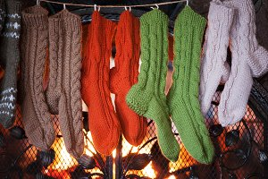 wool socks on a background of fireplace