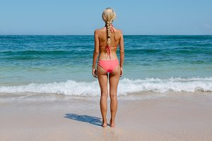 Sensuous woman in bikini at beach