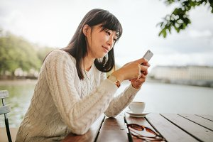 Beautiful asian woman using mobile