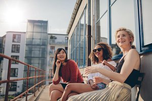 Smiling women relaxing outdoors