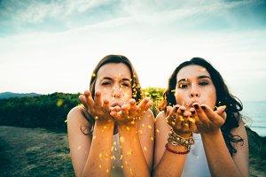 Blowing golden glitter