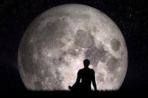 Man looking at the moon.