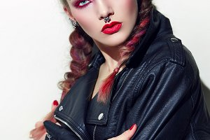 Girl with piercings. Rock style.