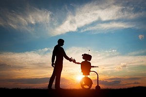 Man and robot meet and handshake.
