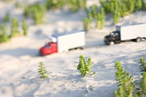 Toy truck rides on the sand
