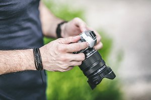 Photo Camera in Man's Hands