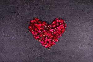 Half heart on wood background dark tone,black