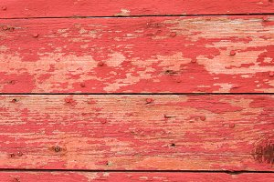 Red pealing painted wood
