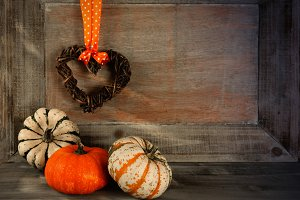 Three pumpkins on a wooden backgroun