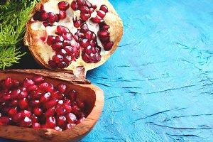 Pomegranate seeds on blue