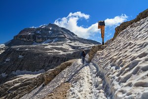 Dolomiti - hiker on snowvy path