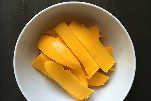 Mango on wood background