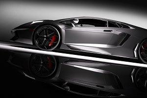 Grey fast sports car in spotlight.