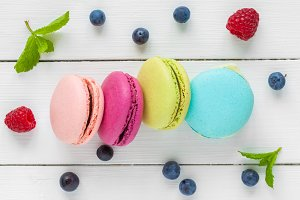 Macaroons, berries and mint.