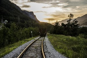 Train traveling in the Sunset