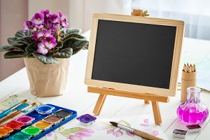 Blackboard and watercolor paints
