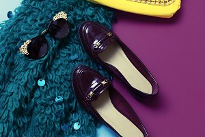 Clutch, glasses, varnish shoes.
