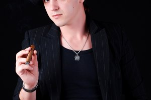 gangster in black suit with cigar