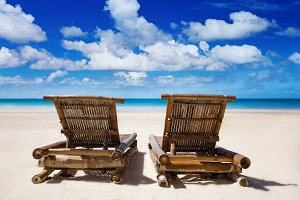 chairs on the white sand beach