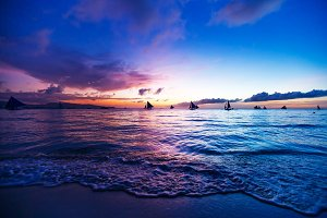 colorful sunset at sea. Sailboats