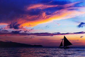 colorful sunset at sea. Sailboat