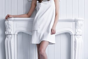 young woman in white short dress
