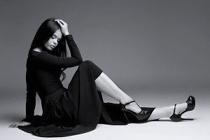 Elegant woman in long black dress