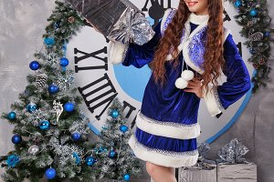 Girl in suit Snow Maiden with gift