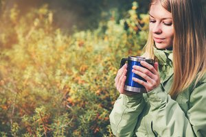 Woman drinking tea outdoor