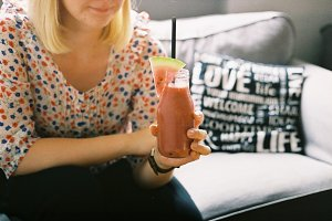 A girl holding a healthy smoothie