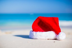 Christmas hat on white beach