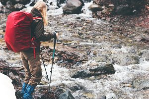 Traveler Woman with backpack hiking