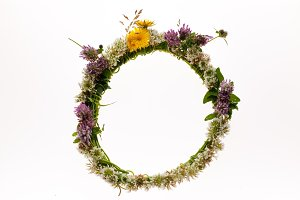 Natural floral wreath on white bg