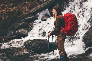 Woman Hiker with backpack traveling
