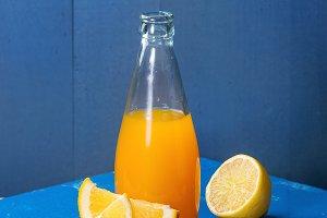 Opened glass bottle of lemonade