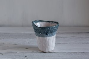 white and turquoise glass of clay